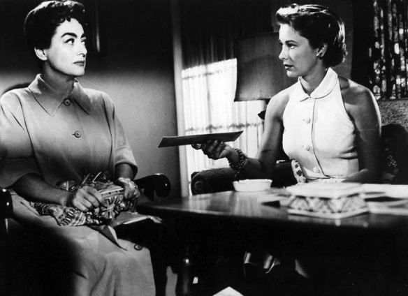 Vera Miles (right) confronts Joan Crawford with the truth about her young, unstable husband in Autumn Leaves (1956).