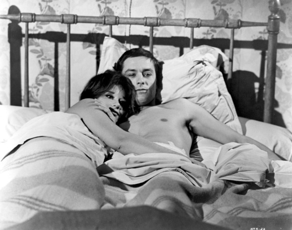 A brief moment of tenderness in the tense political thriller L'Insoumis (1964) starring Lea Massari and Alain Delon.